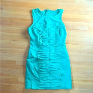 Curve hugging Green Rouched BEBE dress size M EUC